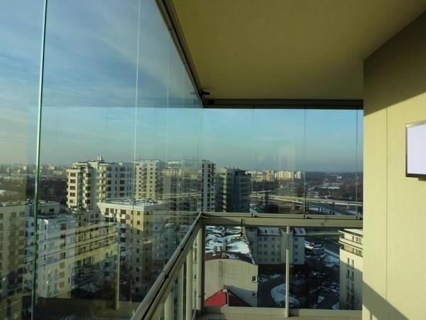 Фото безрамного остекления балконов